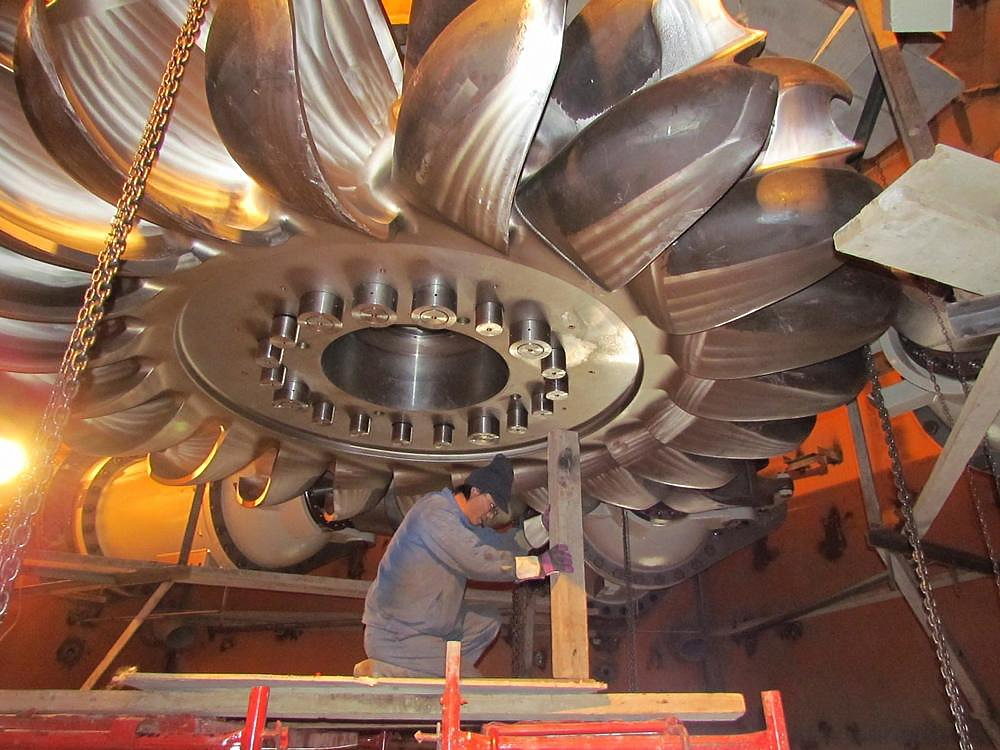 A worker installs a turbine at the Moynak hydropower plant in Kazakhstan's east. (Moynak GES handout)