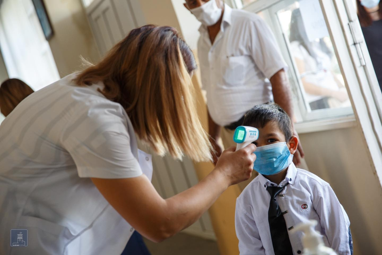Armenian kids head back to school despite smoldering COVID-19 outbreak