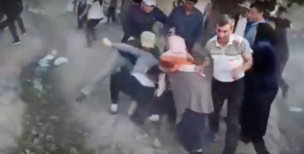 I predict a riot: Just one of many of the brawls captured in grainy mobile phone footage.