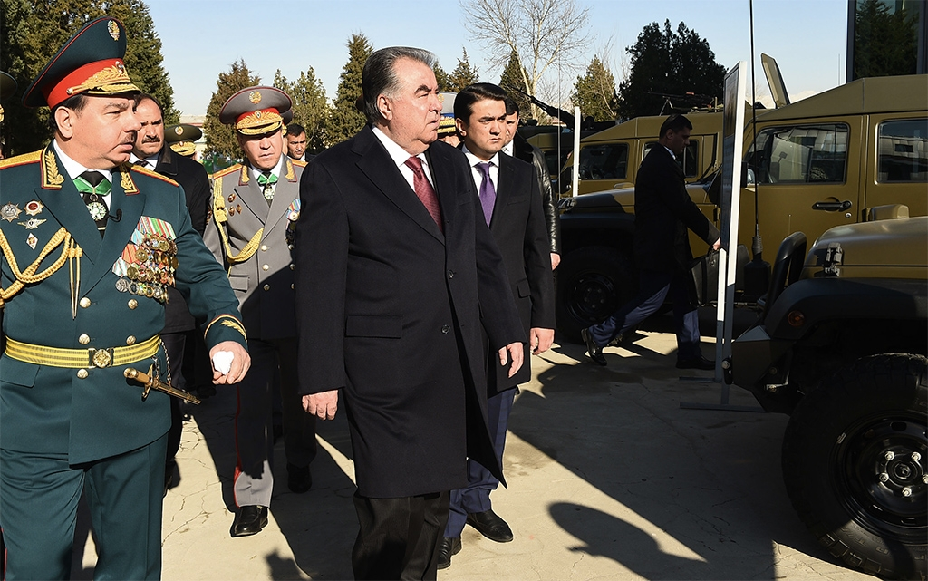 Nice wheels: Tajik President Emomali Rahmon inspects purchases of Chinese military vehicles earlier this year. (government handout)