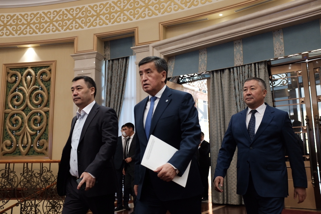 Out with the old, in with the new: Japarov, Jeenbekov and Isayev striding into a congress hall at the State Residence on October 16. (Photo: Danil Usmanov)
