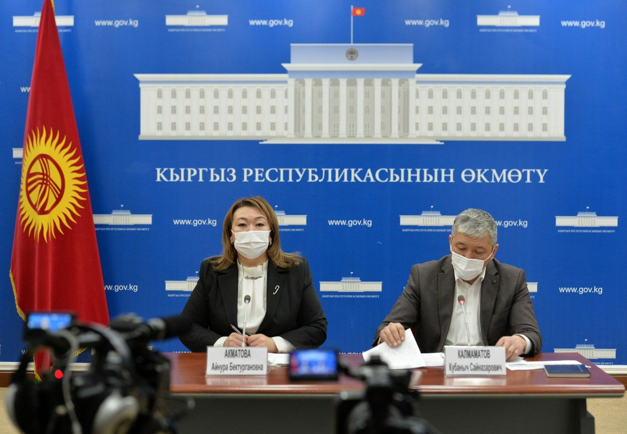 Akmatova, left, speaking at the December 8 briefing. (Photo: Government handout)