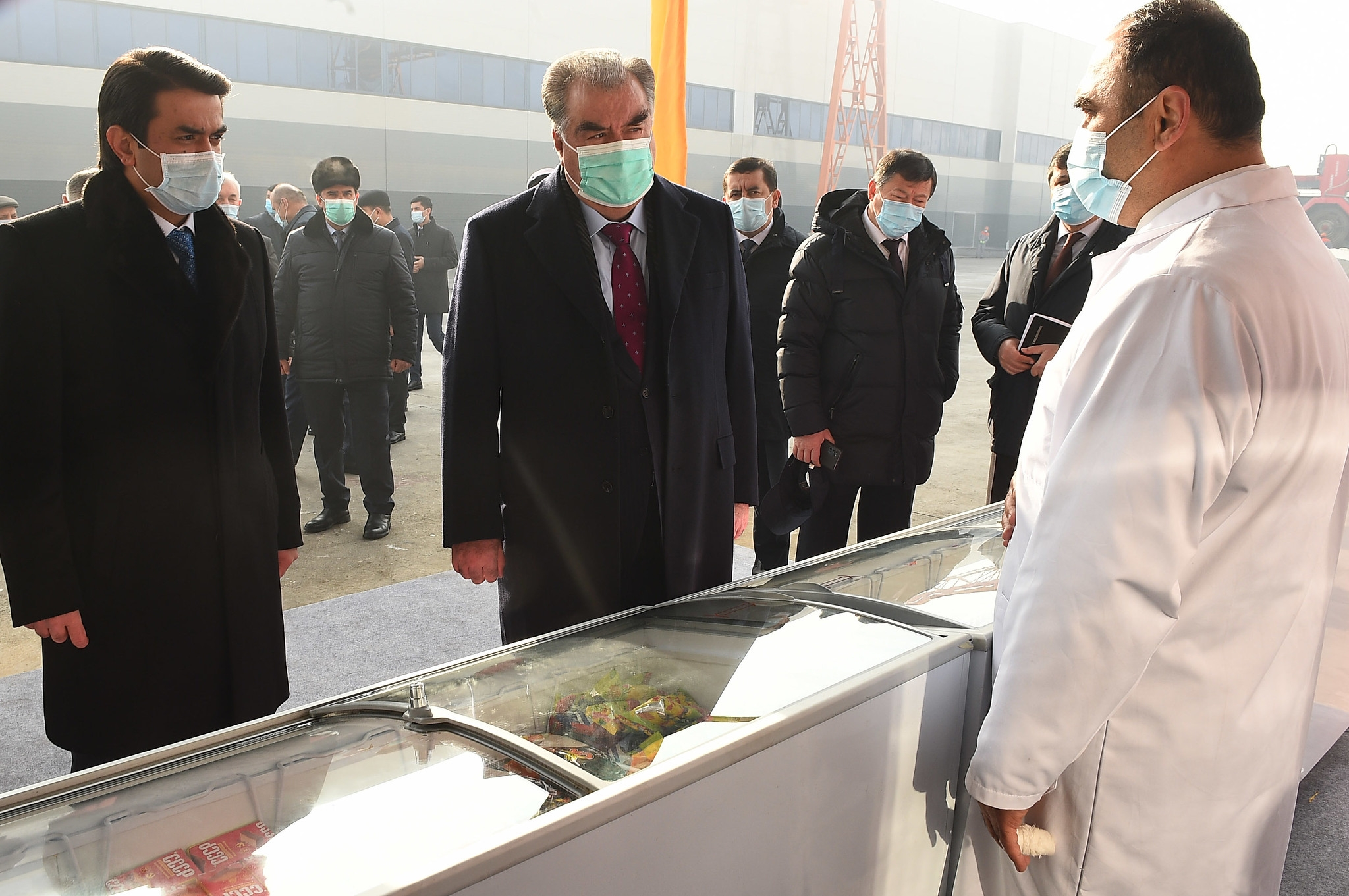 """And will it freeze loans too?"": President Rahmon, center, visiting a food production plant last month. (Photo: Presidential press service)"