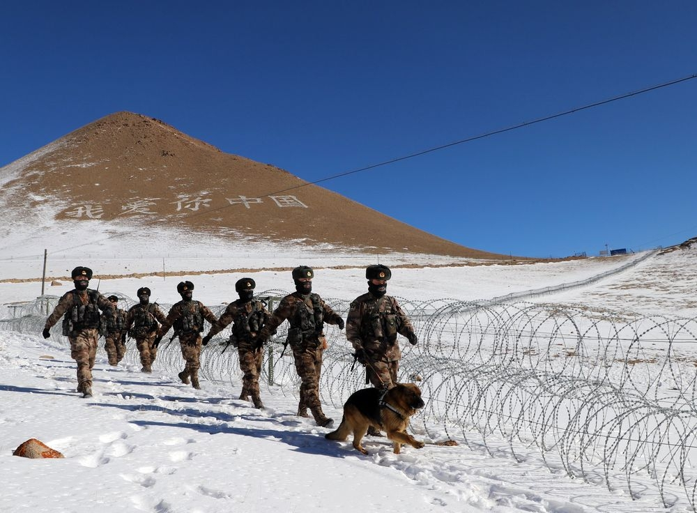 Chinese troops patrol the border with Kyrgyzstan this month (PLA)