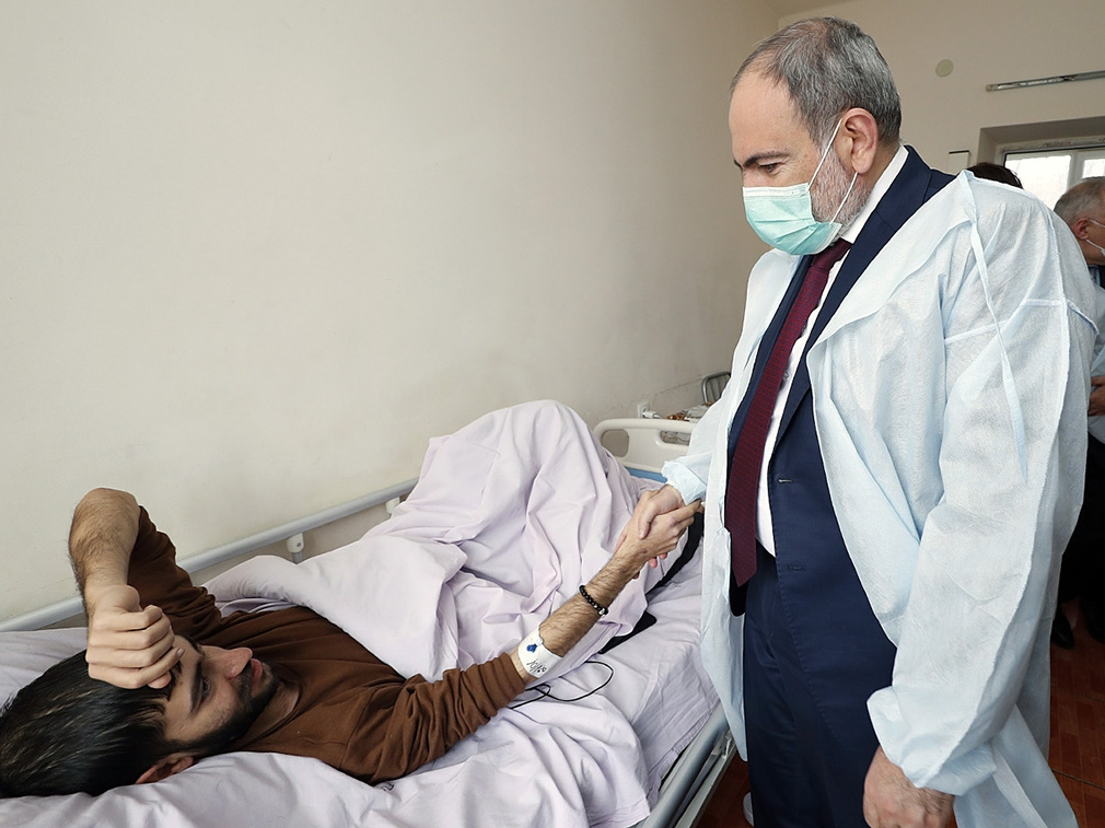 Prime Minister Nikol Pashinyan visiting a servicemember wounded in the war with Azerbaijan. (government handout)