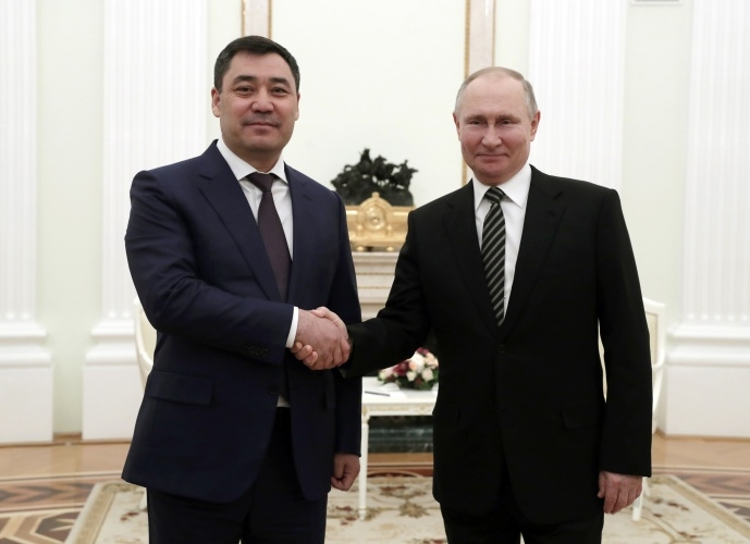 Glad-handing: Japarov, left, meeting with Putin in Moscow. (Photo: Kyrgyz presidential administration)