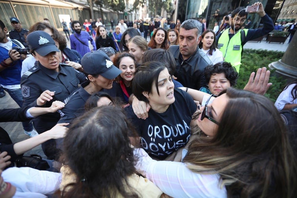 Azerbaijani police detain a women protesting against domestic violence in 2019 (Aziz Karimov/used with permission)