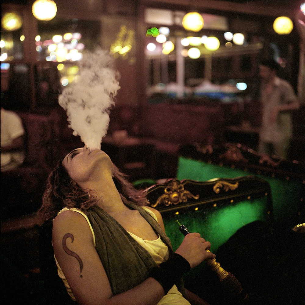 Yanki, a transvestite who moved from Gaziantep to Istanbul, smokes a nargileh in the Istanbul neighborhood of Tophane.