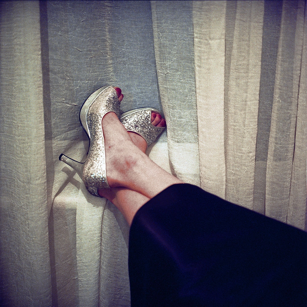 Wearing silver high-heeled shoes, Helin, a transvestite who moved to Istanbul from Ordu, relaxes in her apartment.