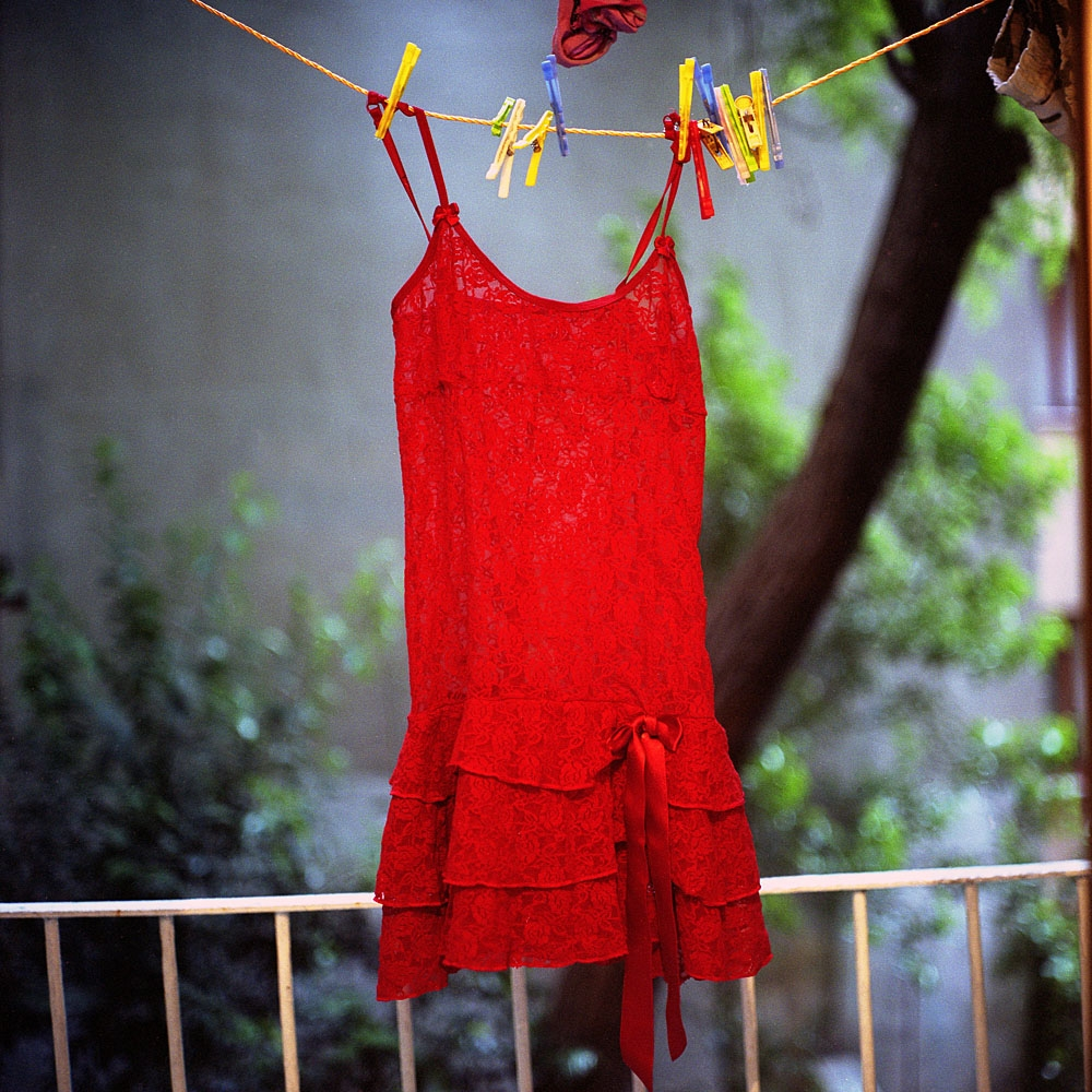 A red lace top belonging to Sechil, a transvestite from Gaziantep, hangs to dry outside her apartment.