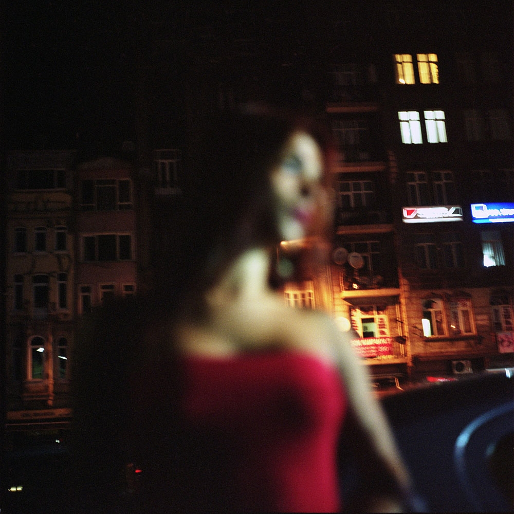 Chisem, a transvestite sex worker, waits for potential customers on Tarlabasi Avenue.