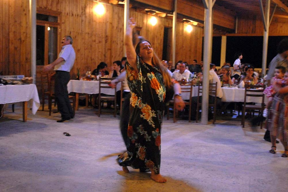 A couple dances during a priest's birthday supra near Tbilisi.