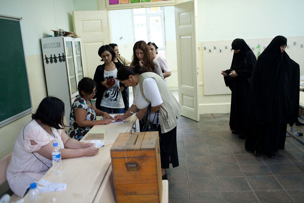 Workers at a polling station in Istanbul's Cihangir neighborhood check-in voters. (Photo: Jonathan Lewis)