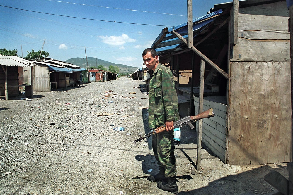 2004: A Georgian policeman guards the Ergneti market, which was closed two months earlier.