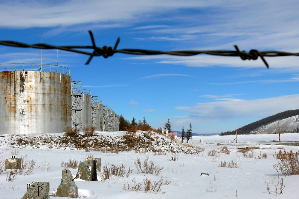 Rusty barbwire still delineate the forbidden zones of the oil depot controlled by the 24th Company.