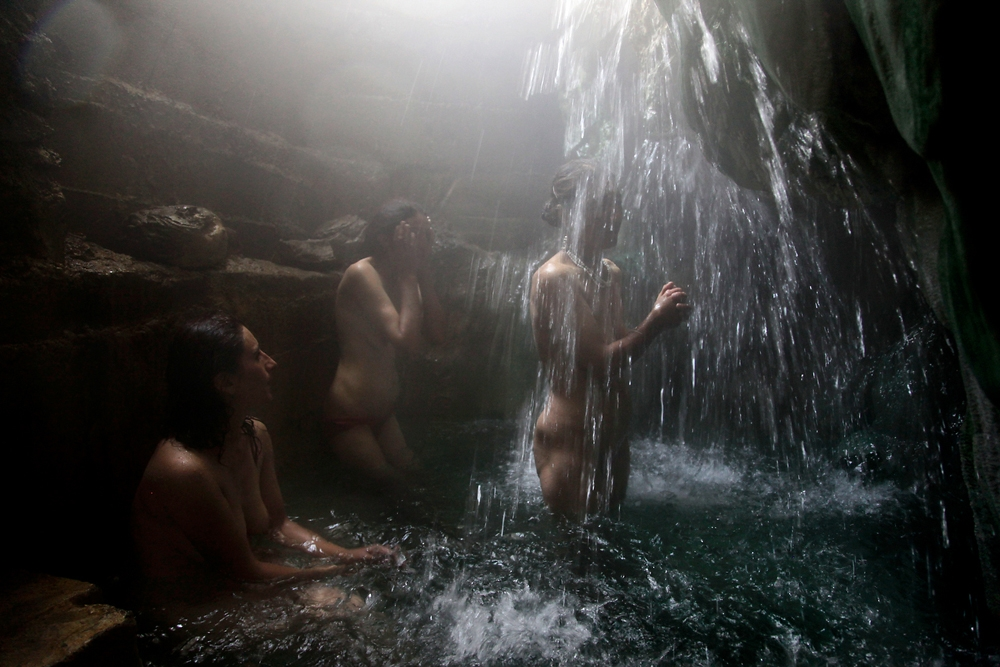 Tajik women bathe in hot springs near Ishkashim.