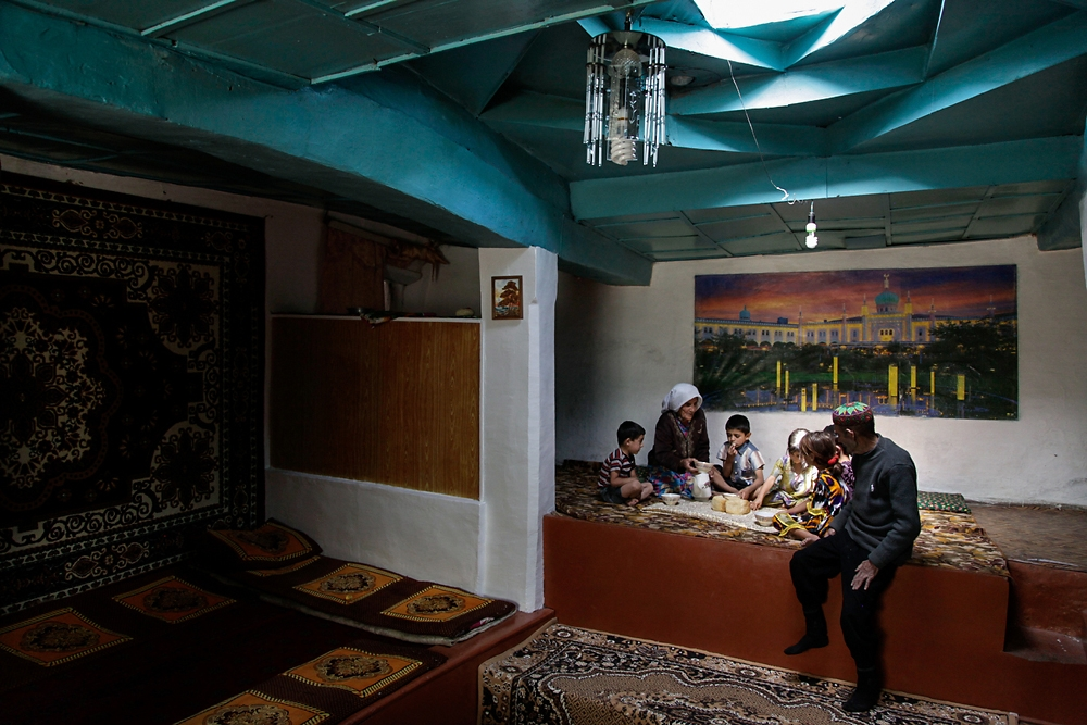 A Tajik family eats in a traditional home in Andarab, Tajikistan.