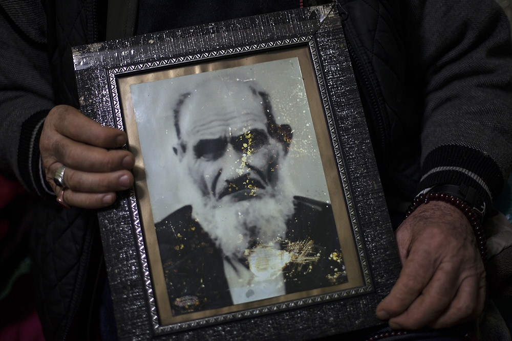 Ferman, a Muslim Armenian man, holds a photo of his father Selim, who escaped the 1915 bloodshed in Turkey.