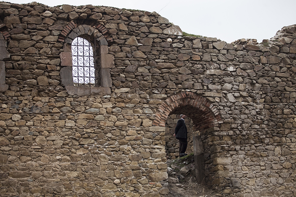A man visits the ruins of an Armenian church in Muş.
