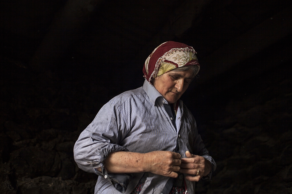 A woman, who speaks Armenian, gets ready to bake bread in her tonir.