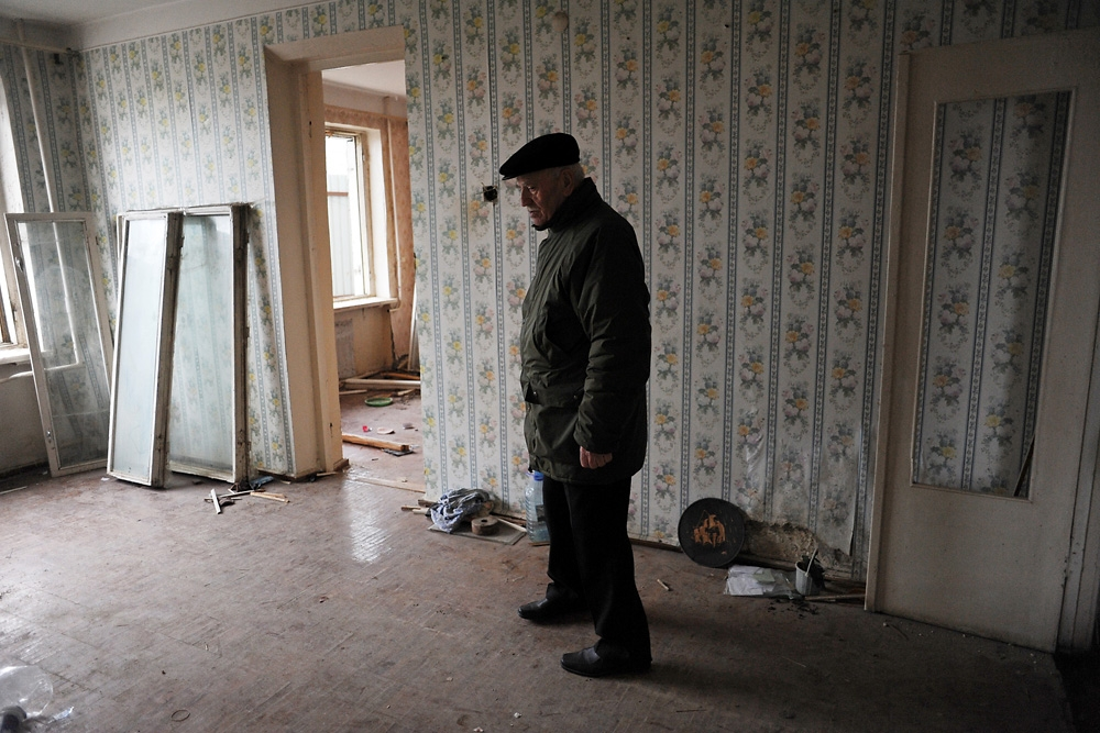 Khaliq Bagirov stands in the shell of his former living room in his partially demolished apartment on Agil Guliyev Street.