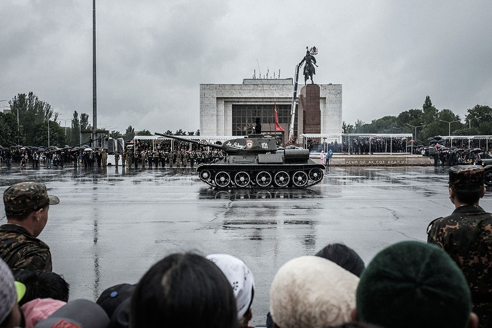 Under a pouring rain Kyrgyz military hardware and soldiers parade through Ala-Too Square on May 9 in celebration of Victory Day.