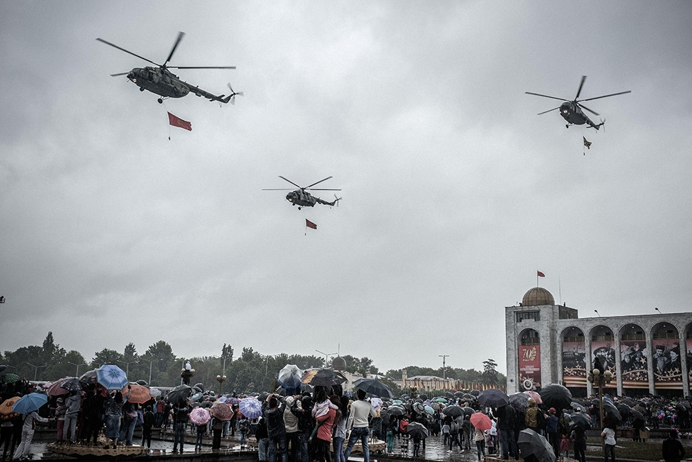 Pulling Kyrgyz flags, Mi-8 helicopters fly over the main square during the 70th anniversary parade.