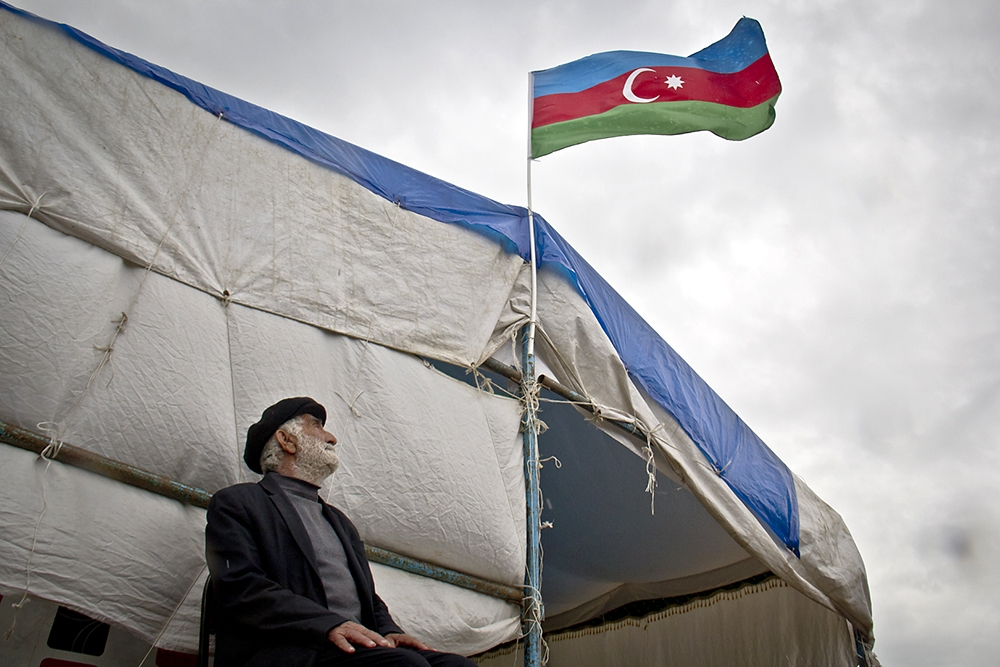 Flying outside a mourning tent in Karakechdi, a flag signals the death of 20-year-old Azerbaijani soldier Ulvin Mammadov.