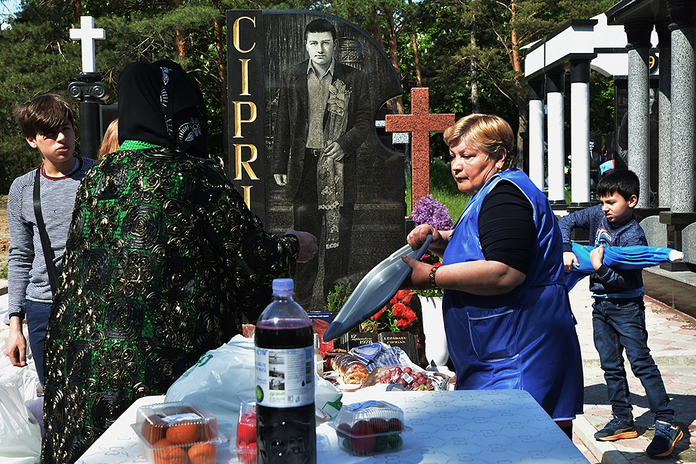 Visitors to Saint Lazarus Cemetery in Chișinău enjoy food and drink at the graves of relatives during Easter of the Dead.
