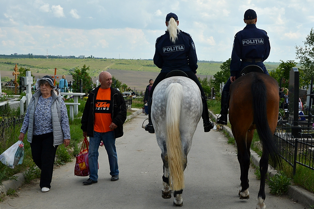 Police on horseback and on foot patrol Saint Lazarus Cemetery during the two-day Easter of the Dead.