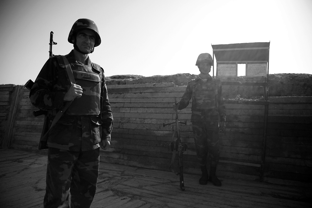 Soldiers patrol the frontline trenches several hundred meters from Azerbaijani troops.