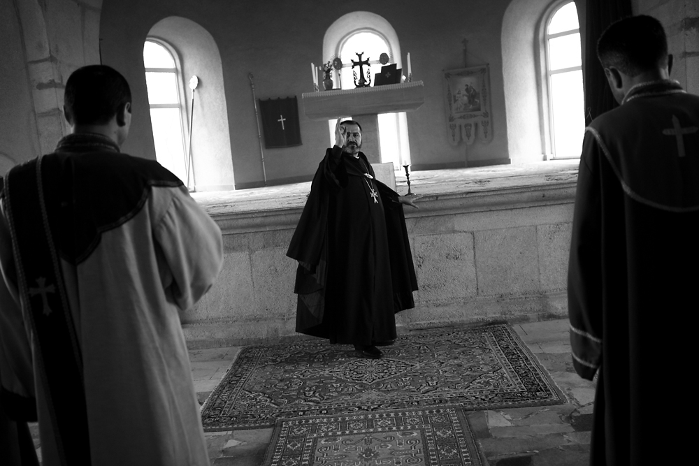 A priest holds service in a church.