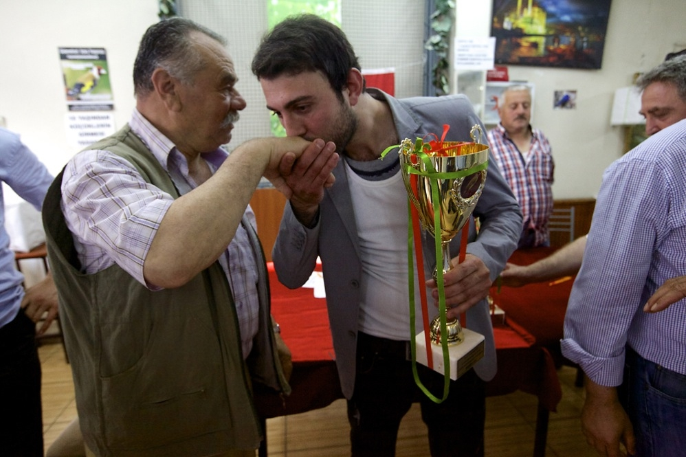 Murat Turan thanks the judges for his goldfinch winning a bird-singing contest in Istanbul. (Alexander Christie-Miller)