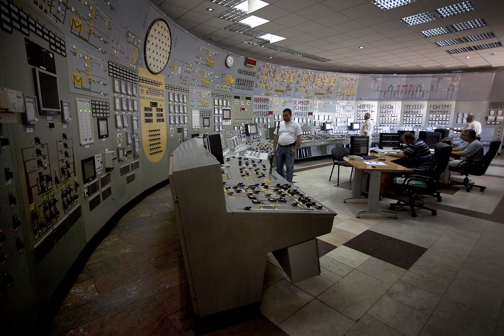 Workers monitor operations in the Metsamor control room.