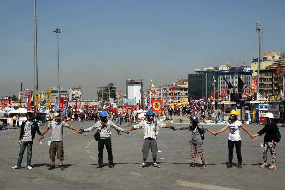 By late morning protesters form the start of a human chain around Taksim Square in Istanbul.