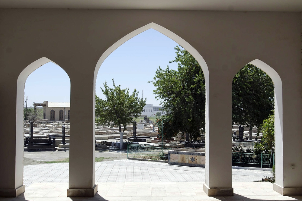 The three-arched entryway opens to the Jewish cemetery on the edge of Bukhara's old town.