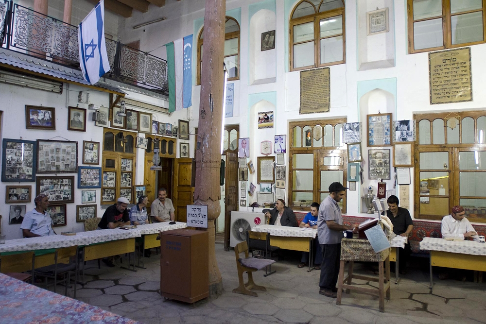 About a dozen men attend a mid-week evening service at the Yahudiylar Machiti Synagogue in Bukhara.