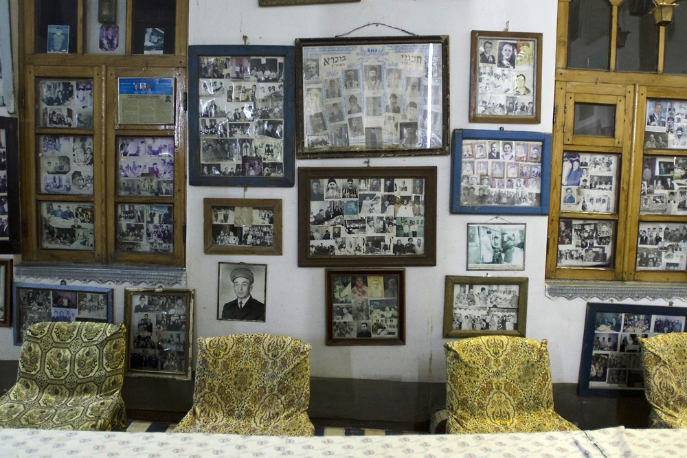 Hundreds of framed photos tracing the 20th Century history of the Bukharan Jews decorate a wall in the synagogue.