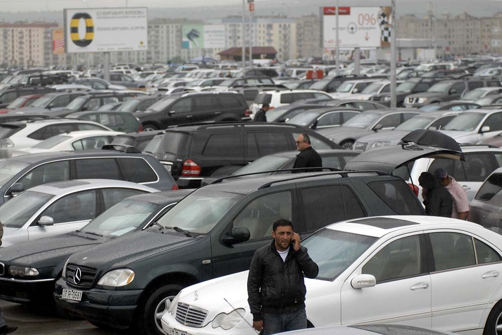 Potential clients browse the estimated 7,000 cars available at the Rustavi Auto Market near Tbilisi.