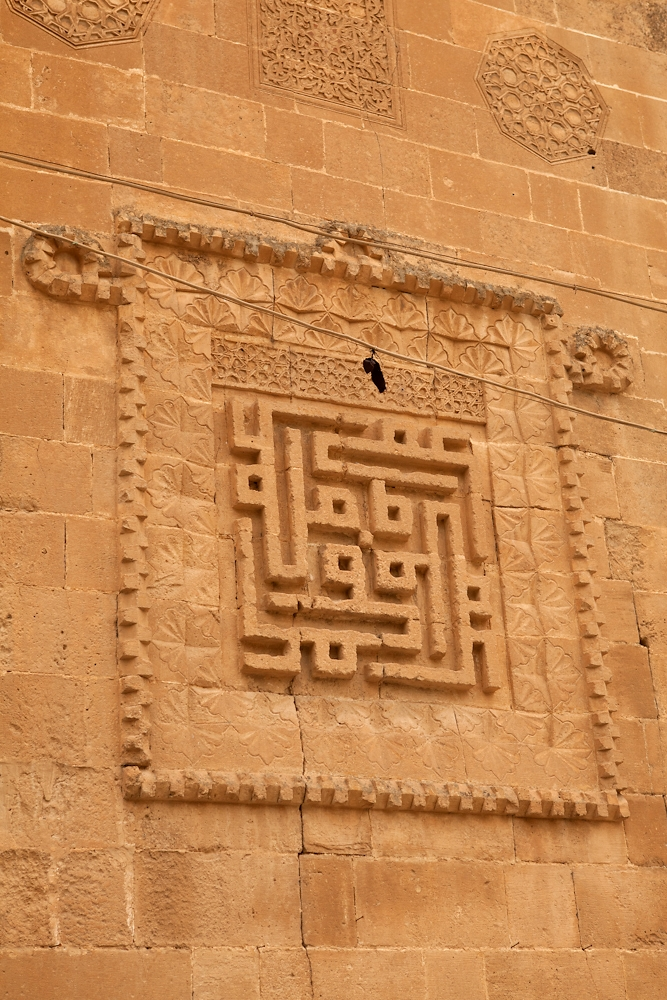 A relief of square Kufic religious script on the El Rizk mosque will be submerged eventually.