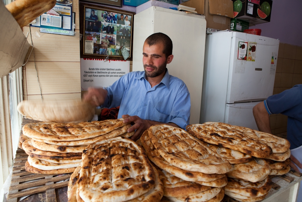 Bakers stack freshly made flat bread in Hasankeyf, where unemployment is high and will likely remain an issue.