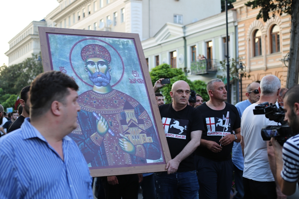 Rally leader Sandro Bregadze (to the right) and an activist carried an icon of King David the Builder at the head of the march.