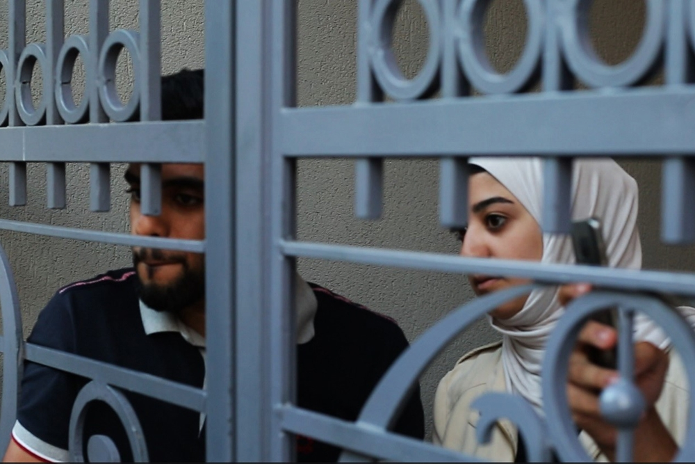 Arab tourists watched the march through a hotel's gates until they were urged by police and bystanders to go inside.