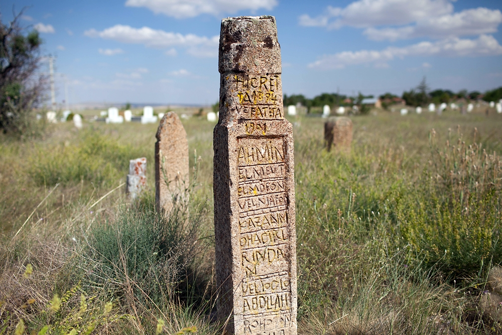 A carved stone marks the grave of one of the first Tatar settlers in Osmaniye.