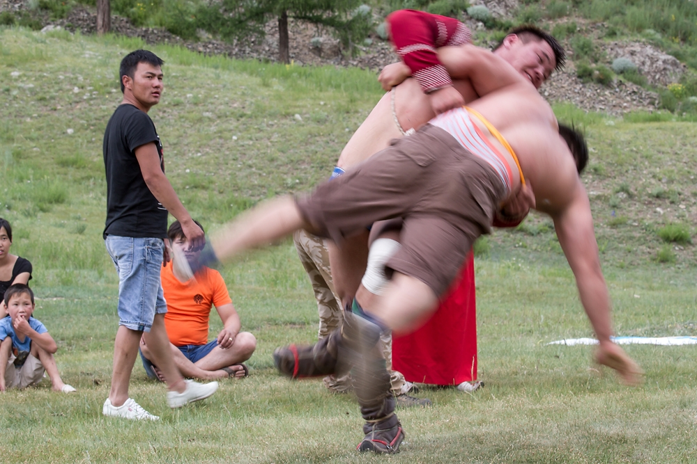 Deft legwork is key to win a Mongolian wrestling match, where the winner is the first to thrown his opponent to the ground.