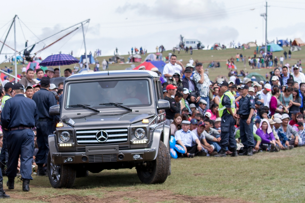 A Mercedes Benz G500 SUV, one of the prizes awarded to the national wrestling champion this year, is paraded to onlookers.