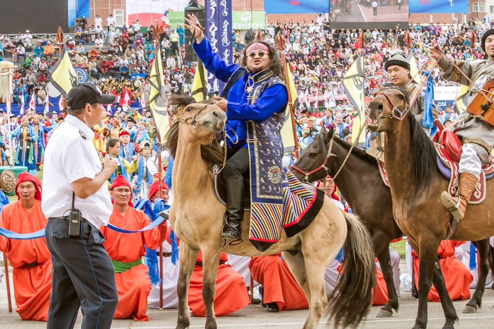 Mongolian rock star Lkhagvasuren, frontman of hard rock band Haranga, sings on horseback during the Nadaam opening ceremony.