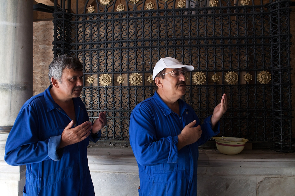 Aziz Tosyali and Suleyman Kok say a small prayer at the 13th century Eyup Mosque before starting work.