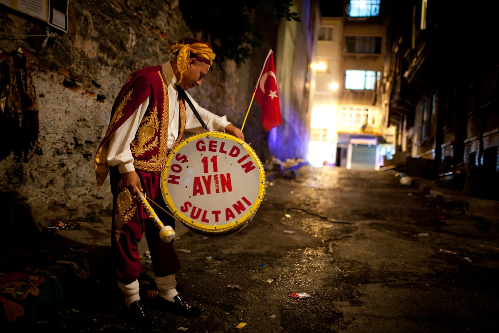 During Ramadan, a drummer dressed in traditional Ottoman clothes, wakes the faithful at night so they may eat before sunrise.