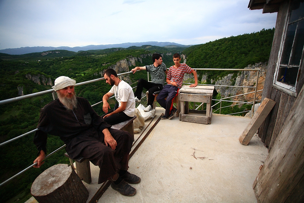 Father Maxim and his volunteers take a break during construction.